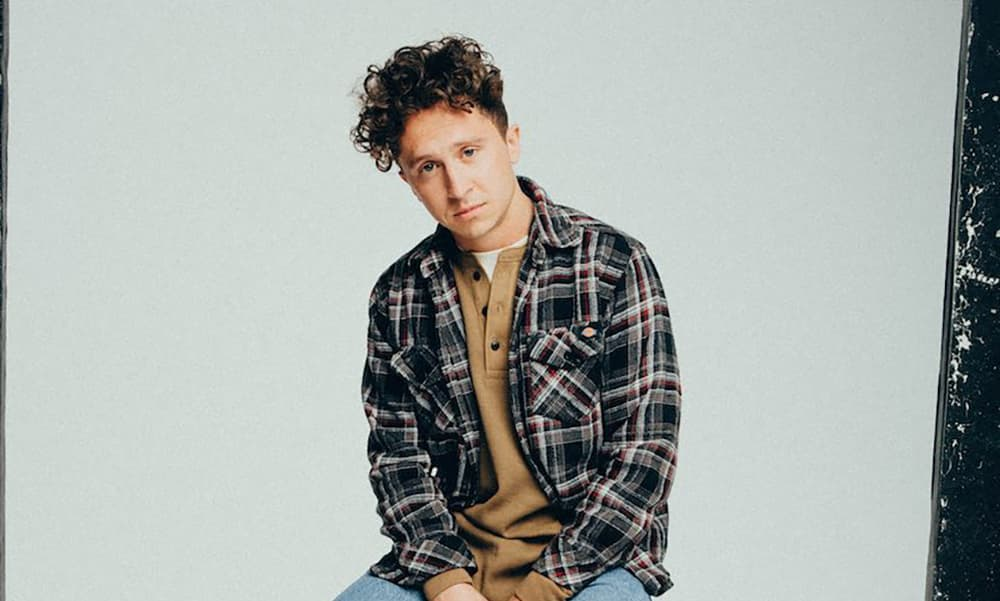 """Joel Baker Teases Debut LP With """"What's A Song"""" Video"""